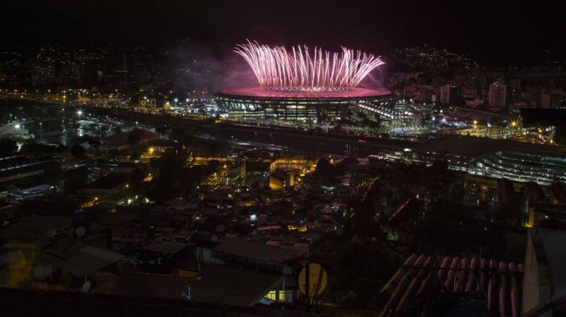 The sight of the Maracana stadium brightly illuminated for the closing ceremony while a power cut plunged neighbouring streets into darkness epitomised the lopsided benefits of the games. (Photo: AP)