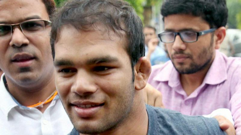 Amid scenes of complete pandemonium at the NADA headquarters, Narsingh Yadav was accompanied by not just lawyers but also his supporters, who shouted slogans demanding justice for him. (Photo: PTI)