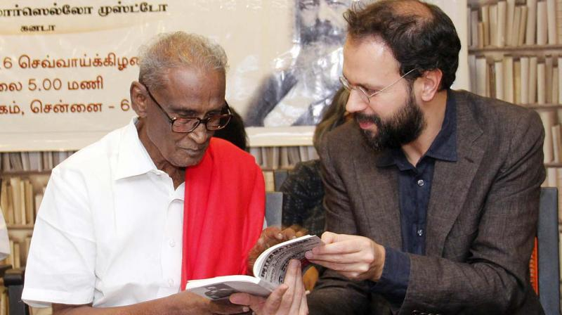 Academician Marcello Musto interacts with CPI leader D. Pandiyan at an event to launch a book on the history and tradition of international labour unions on Tuesday.