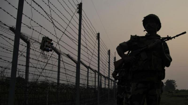 Border Security Force soldiers patrol near the India-Pakistan international border area at Gakhrial boder post in Akhnoor sector. (Photo: AP)