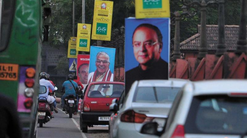 Flex boards on BJP national committee meet are seen around Mananchira square, violating a corporation ban. (Photo: VENUGOPAL )