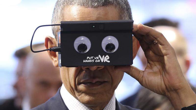 a0bd067cef88 US President Barack Obama trying on a VR headset (Photo  AP)
