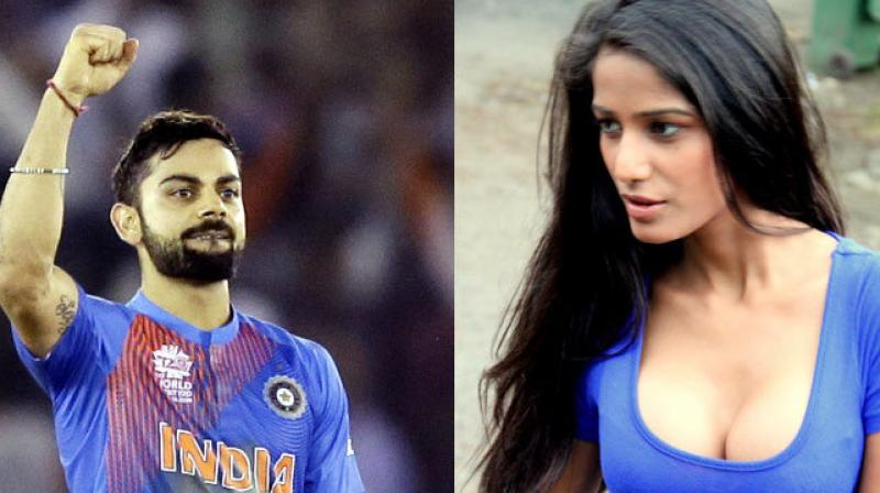After the hosts made it to the semis from Group 2, Poonam Pandey didn't take long to post pictures of herself in a steamy tribute to the man of the moment Virat Kohli and the 'Men in Blue'. (Photo: AP)