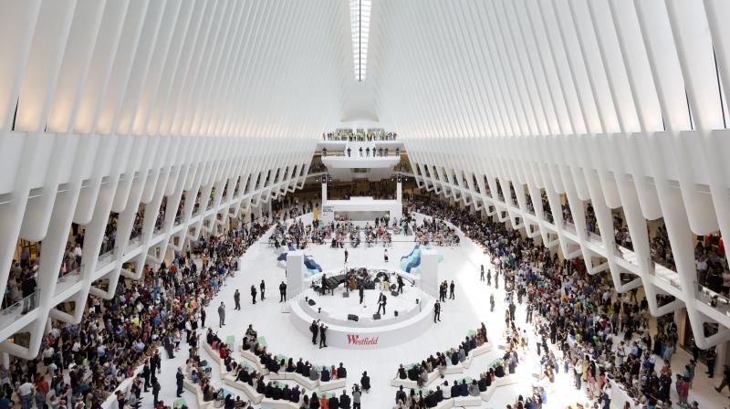 Crowds gather for a celebration for the opening of the Westfield World Trade Center mall in the oculus of the Transportation Hub, Tuesday. (Photo: AP)