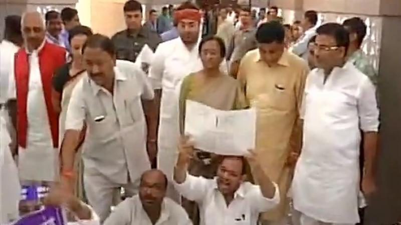 BJP, Congress and BSP MLAs jostled with other legislators and continued to raise slogans while marshals tried to remove them. (Photo: ANI)
