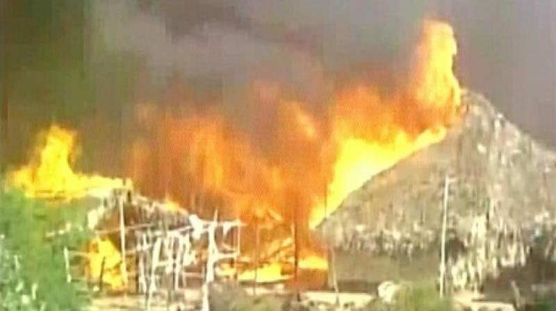 More than hundred shanties were gutted in a fire that broke out in Kakinada. (Photo: ANI Twitter)