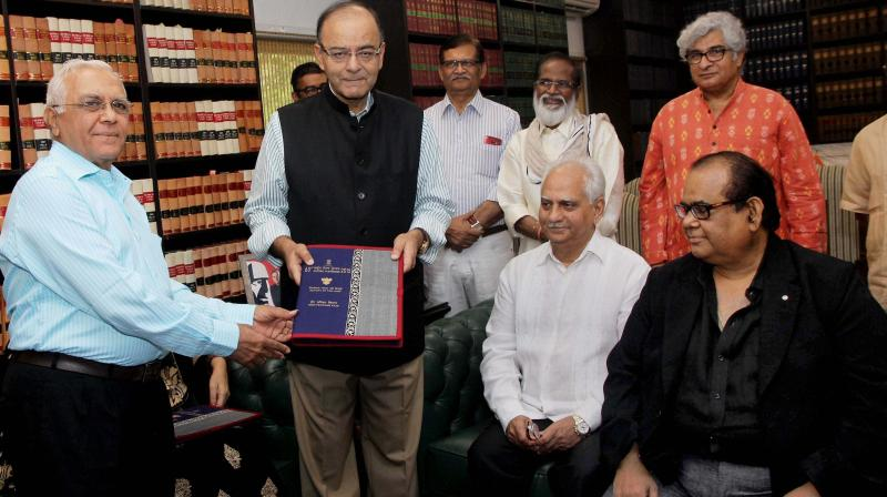 Union I & B Minister Arun Jaitley receiving the report for the 63rd National Film Awards from Vinod Ganatra, chairperson of the jury on Non Feature Films, in New Delhi. (Photo: PTI)