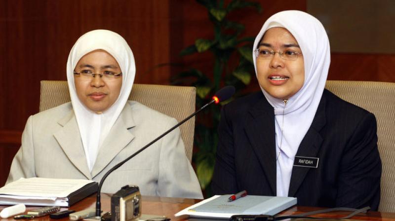 Rafidah Abdul Razak and Suraya Ramli, two newly appointed female Syariah Court judges, during a press conference in Putrajaya, Malaysia. (Photo: AP)