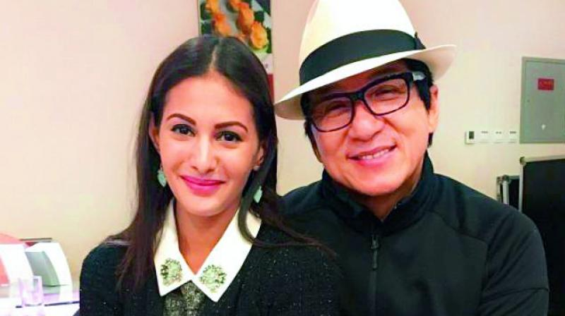 Amyra Dastur with Jackie Chan. The two star in Kung Fu Yoga