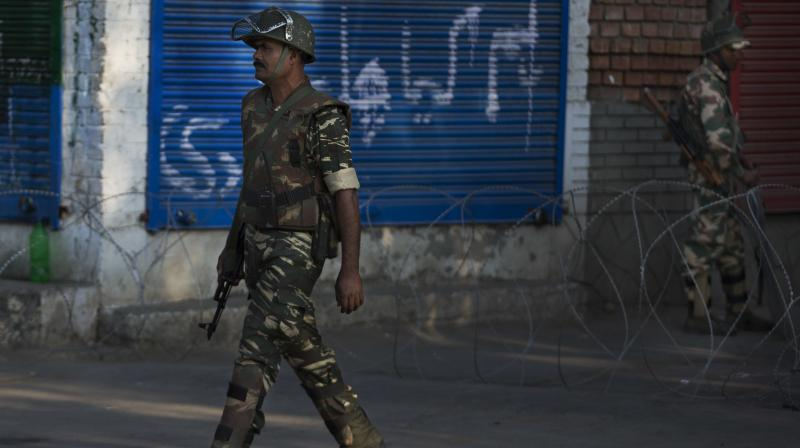 Soldiers patrol along a closed market in Srinagar after India carried out surgical strikes in Pakistan against terrorists. (Photo: PTI)