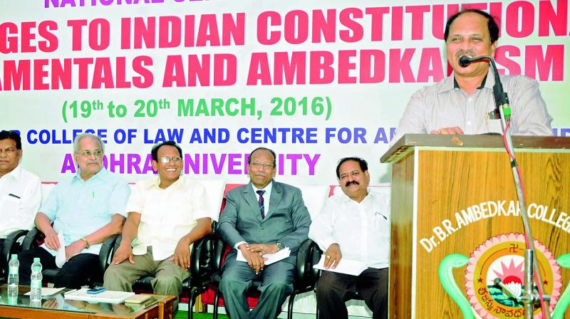 AU Registrar Prof V. Uma Maheshwara Rao addresses a national seminar on Indian Constitution in Vizag. (Photo: DC)
