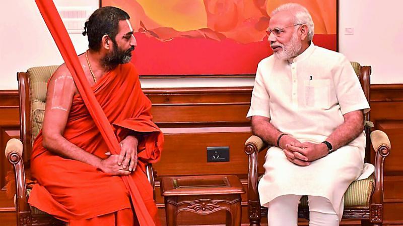 Tridandi Srimannarayana Ramanuja Chinna Jeeyar speaks with Prime Minister Narendra Modi in New Delhi on Sunday.