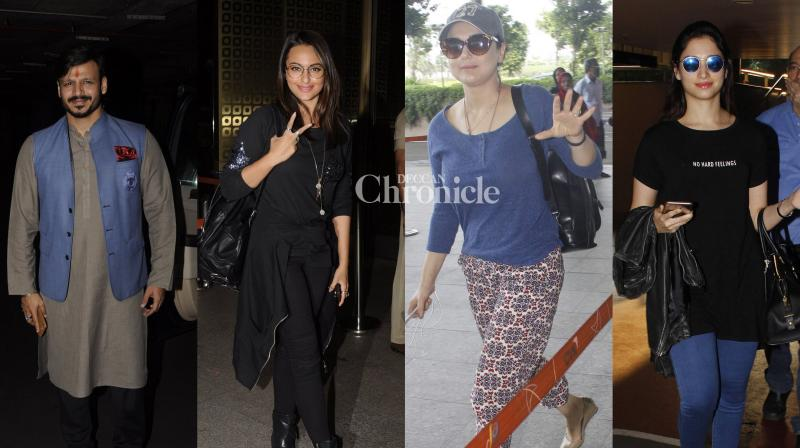 Bollywood stars stepped out in their fashionable best while travelling as they were snapped at the Mumbai airport on Monday. (Photo: Viral Bhayani)