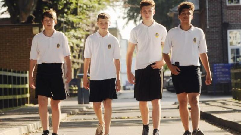 b9e4ed9cb6b UK school boys wear skirts to protest shorts ban