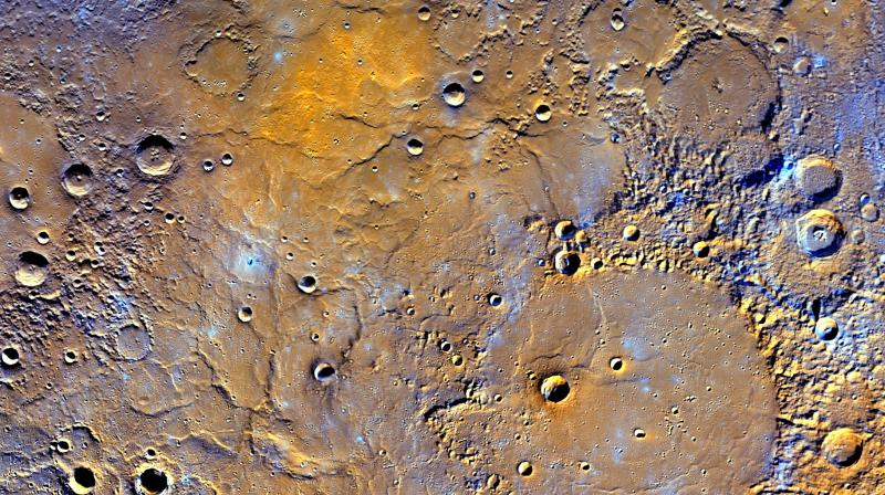 A view of Mercury's northern volcanic plains is shown in enhanced color to emphasize different types of rocks on Mercury's surface. (Photo: NASA)