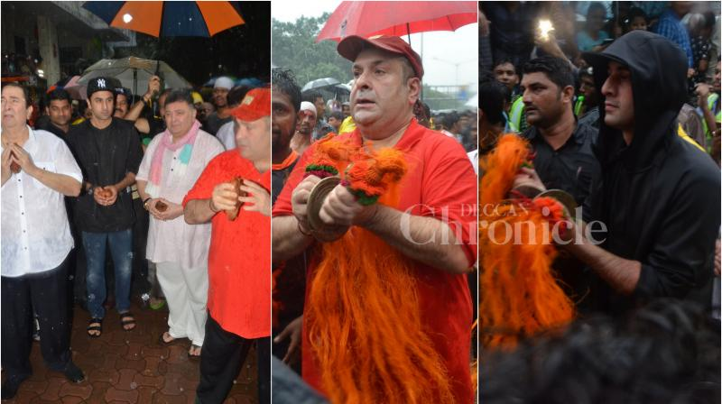 On Thursday, Randhir, Rishi, Rajiv and Ranbir Kapoor celebrated Bappa's farewell. With heavy downpour, the Kapoor's chanted 'Morya' as they bid adieu to their RK Studios' Lord Ganesha. (Photo: Viral Bhayani)