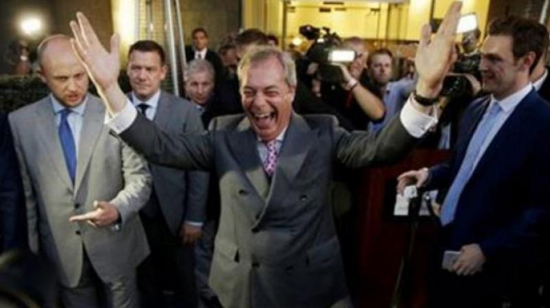 Nigel Farage, the leader of the UK Independence Party, celebrates and poses for photographers. (Photo: AP)