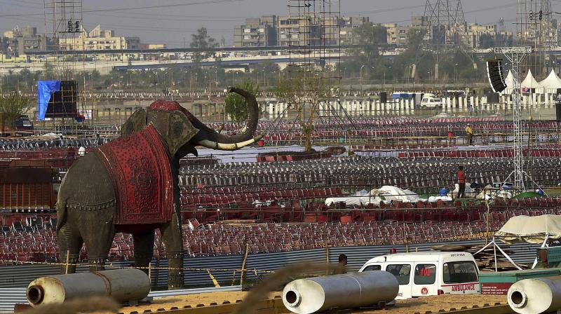 Workers make arrangements for the three-day World Peace Festival organised by spiritual guru Sri Sri Ravi Shankar in New Delhi. (Photo: PTI)