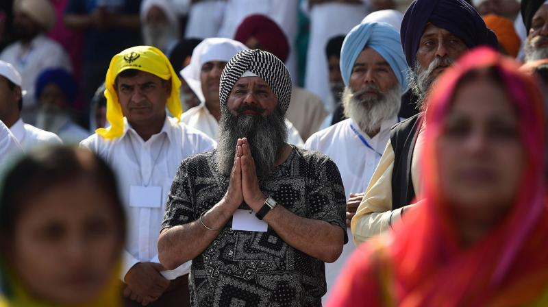 A true Sikh is always imbued with the firm faith in the oneness of God (Ek-Onkar).