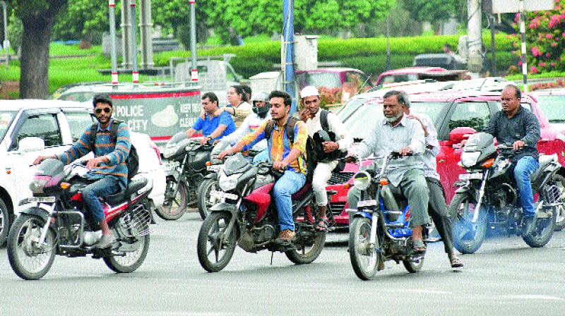The cases booked against two-wheeler riders have not come down.(Photo: S. Surender Reddy)