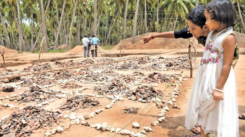 Students of Fatima College, Madurai are seen viewing the excavation site at Keezhadi near Sivaganga on Friday.