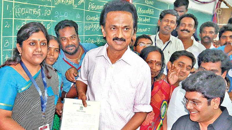 After winning his Kolathur seat, DMK treasurer M.K. Stalin receives the certificate from election commission officials at Ayanavaram zonal office on Thursday. —DC