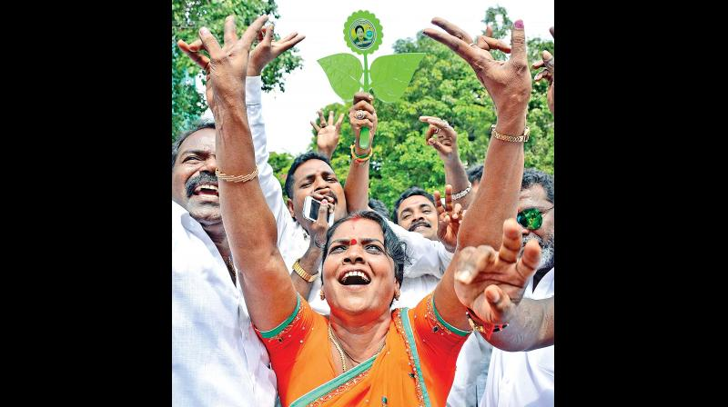 An AIADMK cadre celebrates the party's victory on Thursday near Chief Minister J. Jayalalithaa's Poes Garden residence in the city. —DC