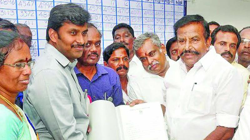Former minister and DMK nominee for Tiruchy west constituency K.N. Nehru, who defeated his nearest AIADMK rival and government chief whip R Manoharan by a margin of 28,415 votes, receiving his winner's certificate from returning officer Ganeshkumar in Tiruchy on Thursday. —DC
