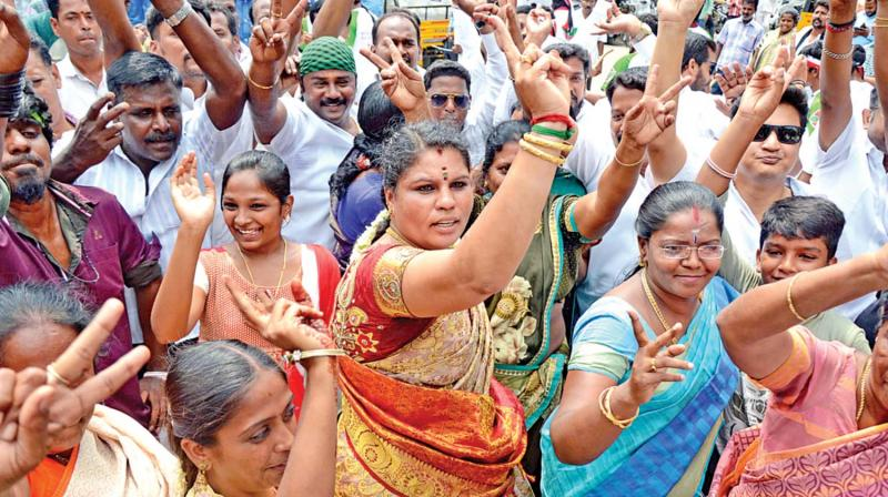 Jubilant AIADMK cadres celebrate their victory by dancing in Coimbatore on Thursday. 	— DC