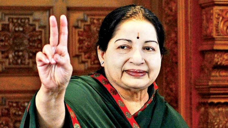 Chief Minister and AIADMK supremo J. Jayalalithaa flashes victory sign after her party emerged victorious in the state Assembly polls, in Chennai on Thursday. — DC