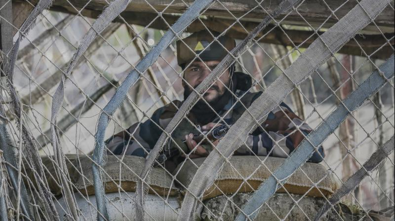 Indian Army soldier guards his post outside the base camp in Baramulla. (Photo: PTI)