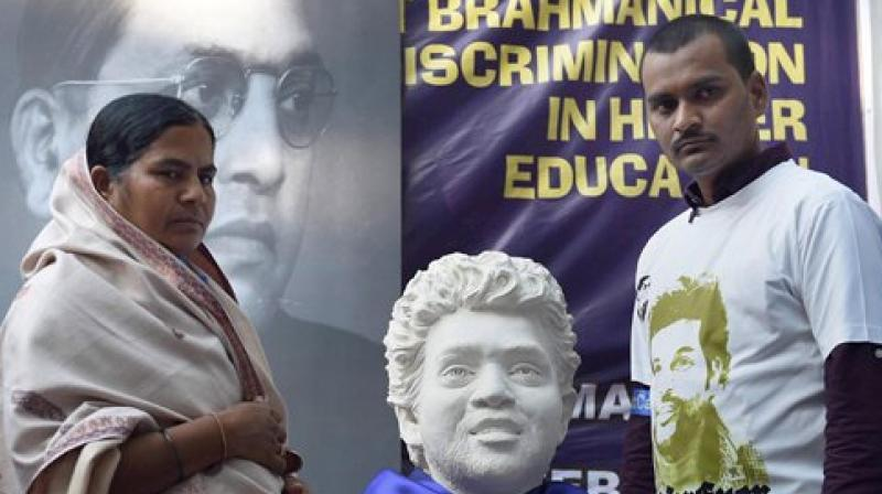Rohith Vemula's mother Radhika and brother at a protest rally. (Photo: PTI)