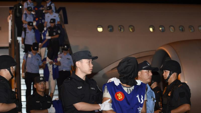 Cambodia deports 63 Chinese arrested for telecom extortion