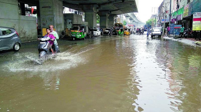 Water Stagnates On The Road At Malakpet Following Rain On Monday Night And On Tuesday