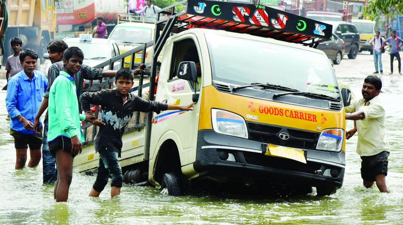 A good vehicle is marooned in the middle of the street at Nacharam (Photo: DC)
