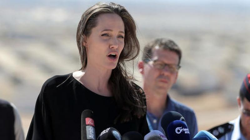 Actress and UN refugee agency envoy special envoy Angelina Jolie talks during a visit to a Syrian refugee camp in Azraq in northern Jordan. (Photo: AP)
