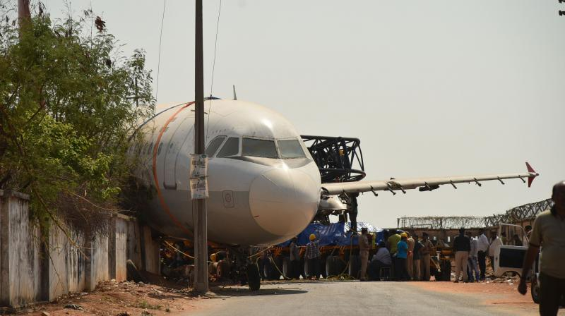 The crane carrying an Air India aircraft lost its balance and crashed near Begumpet airport. (Photo: S. Surender Reddy)