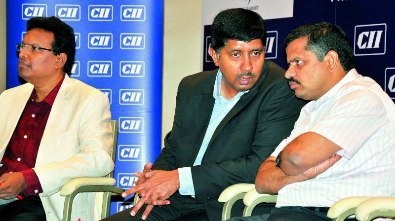 Vice-President of CII AP G.S. Siva Kumar has a word with district collector N. Yuvraj.