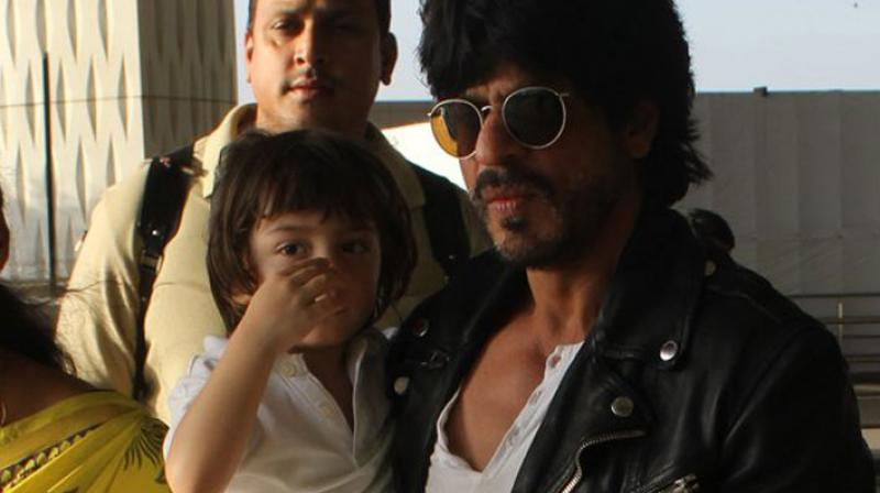 Hot daddy Shah Rukh Khan and his 'little Knight' AbRam, were spotted at the Mumbai airport en-route to a KKR match in Kolkata. Photo: Viral Bhayani