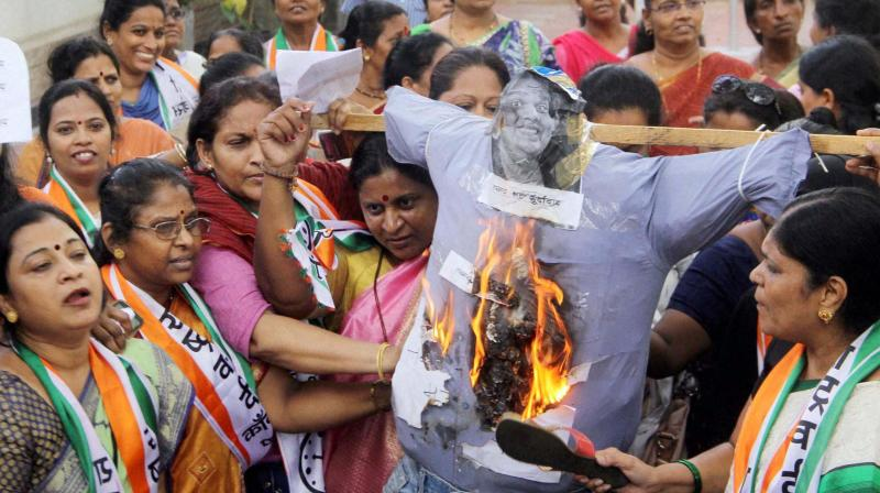 Nationalist Congress Party women activists protest against comedian and founder of All India Bakchod (AIB) Tanmay Bhat for posting a video on Facebook titled Sachin vs Lata Civil War, at NCP Bhavan, in Mumbai. (Photo: PTI)
