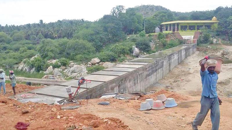 Construction going on in Palar dam at Pullur. (Photo: DC)