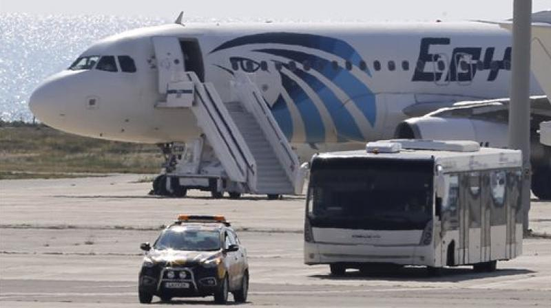 A bus carrying some passengers from the hijacked EgyptAir aircraft as it landed at Larnaca airport. (Photo: AP)