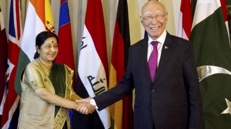 Sources said Aziz and Swaraj, if they meet, will discuss the possibility of an interaction between Prime Minister Nawaz Sharif and his Indian counterpart Narendra Modi later this month in Washington. (Photo: PTI)
