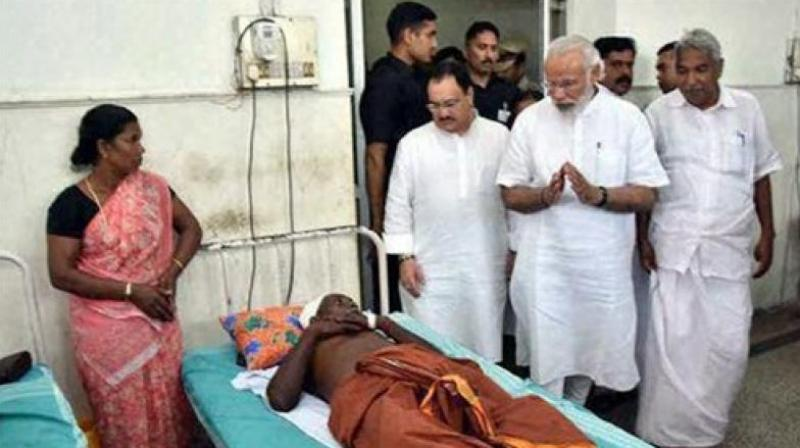 Prime Minister Narendra Modi along with Chief Minister Oommen Chandy had visited the victims of the Puttingal temple fire. (Photo: Twitter)