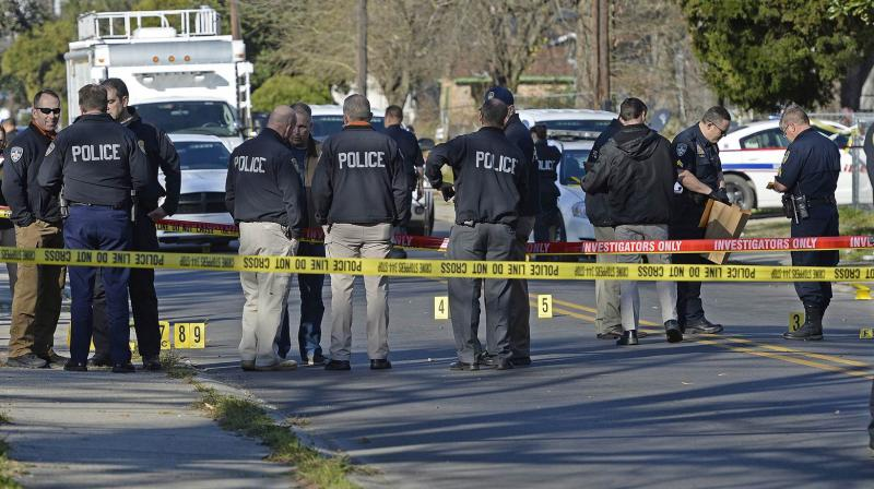 Officers investigate the scene of a shooting in Baton Rouge. (Photo: AP)