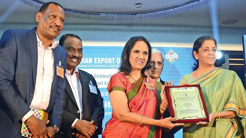 Mallika Mohandas, chairman, MIOT International, receives the award, on behalf of the hospital, for the best service provider in the southern region from Nirmala Sitharaman, minister of state (independent charge) for commerce and industry during the FIEO Southern region exports awards and golden jubilee celebrations. Overseas manager, MIOT international, Jalal and others look on (Photo: DC)