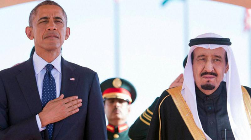 Barack Obama and King Salman bin Abdul Aziz stand during an arrival ceremony in Riyadh, Saudi Arabia.