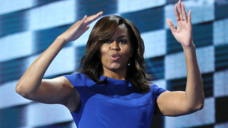 In this election, there is only one person who I trust with that responsibility, only one person who I believe is truly qualified to be president of the United States and that is our friend Hillary Clinton, says Michelle Obama. (Photo: AP)