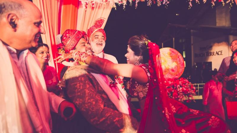 The Couple And Their Familes Share A Light Hearted Moment During Wedding Ceremony