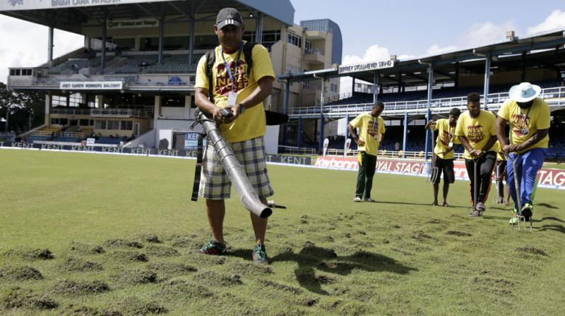 Despite the best efforts of the ground staff, conditions did not improve satisfactorily on the third day for play to be possible in the morning session. (Photo: AP)